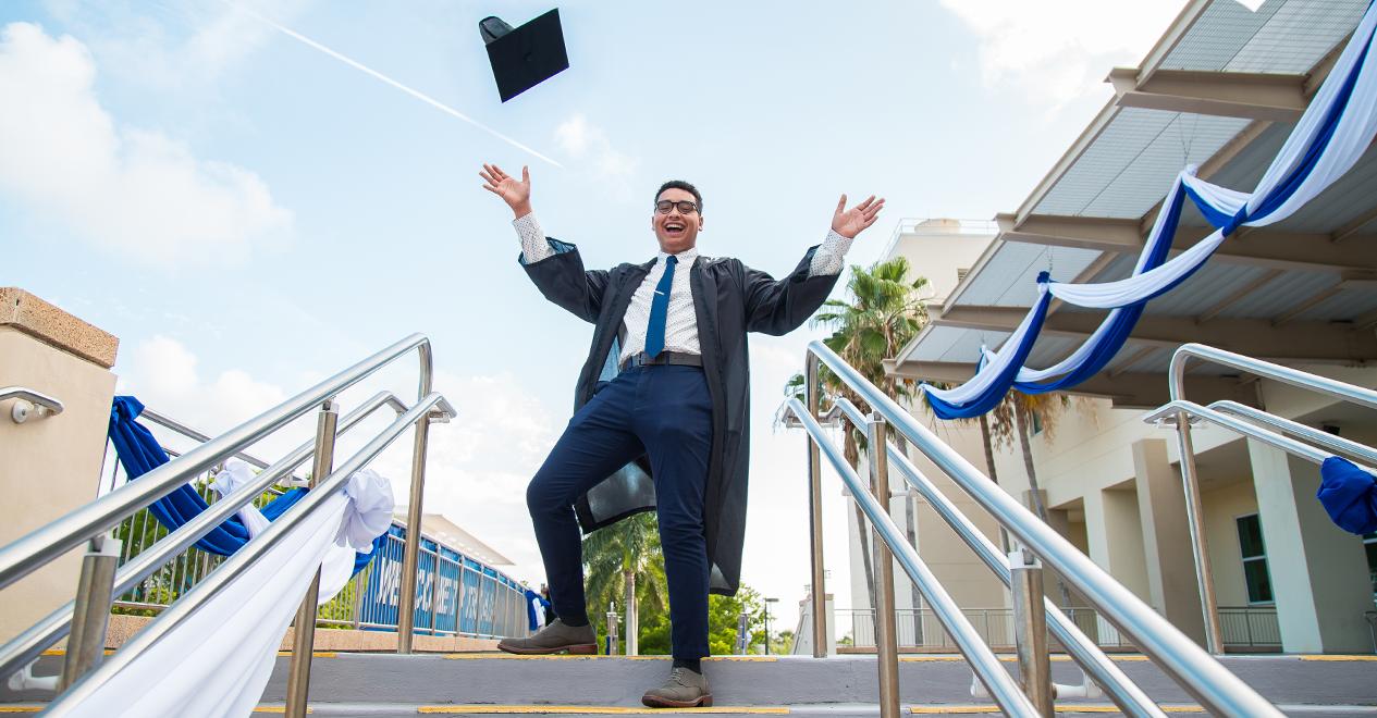 MDC alumni tossing graduation cap