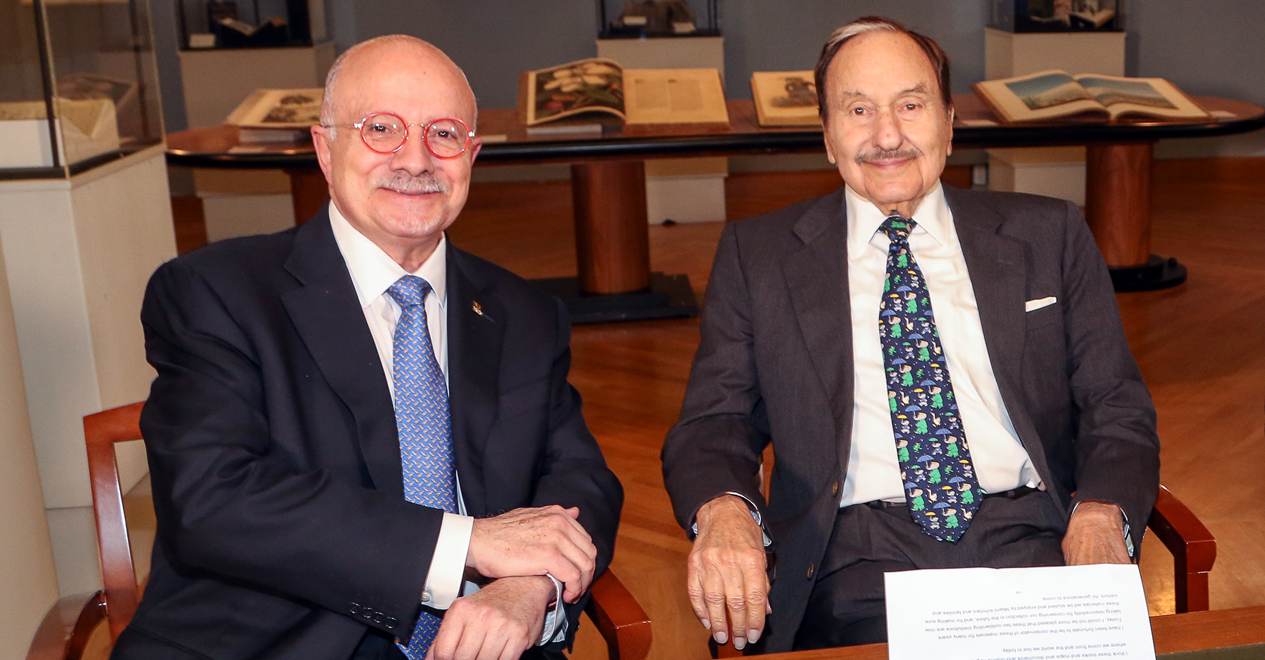 Dr. Eduardo Padrón sitting next to Jay Kislak