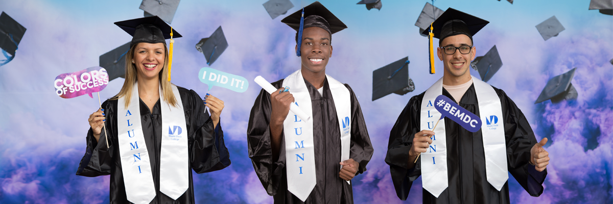 MDC students wearing cap and gown with alumni stole