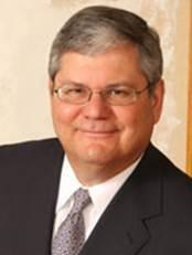Portrait photo of Miguel G. Farra