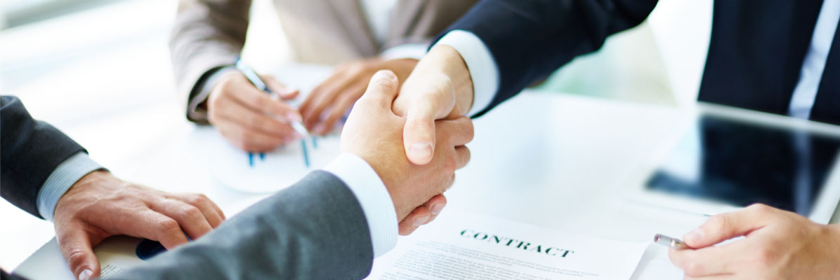 Photograph of professionals shaking hands