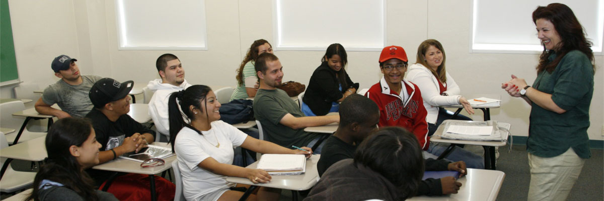 Students and faculty smiling in classroom