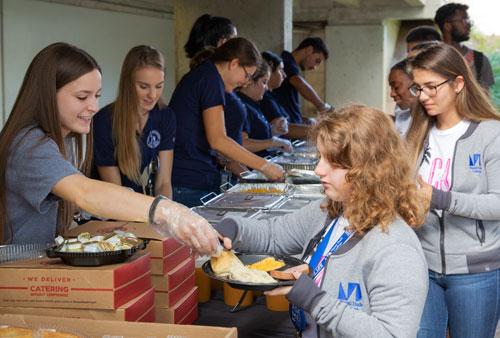 MDC volunteers distributing food to students