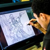 Student drawing digital at MAGIC
