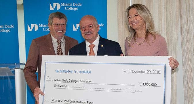 Dr. Eduardo J. Padrón receiving donation check