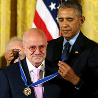Dr. Padrón receiving the Presidential Medal of Freedom by Barack Obama