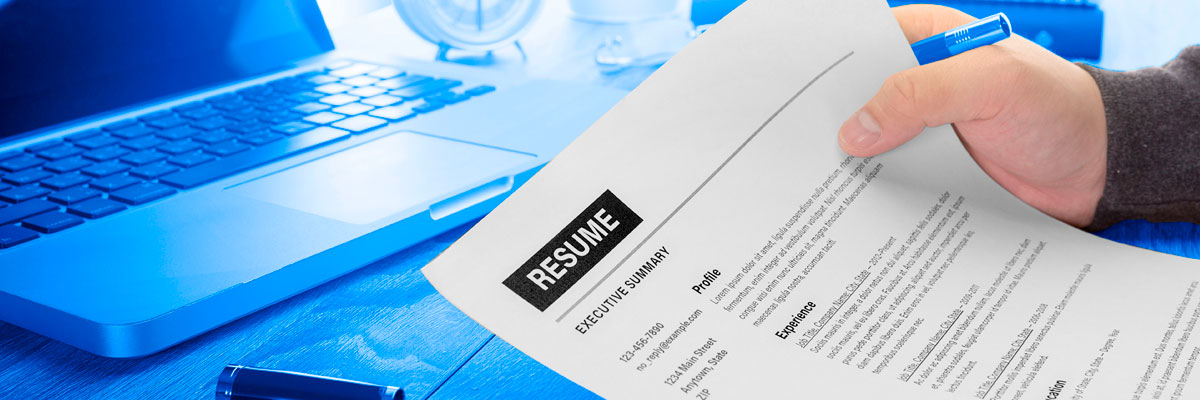 Hand holding a resume paper