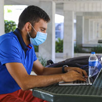 MDC student studying with laptop