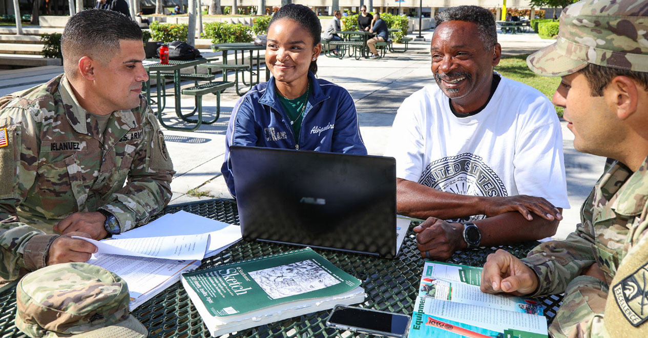 Veterans and students studying outdoors in round-table