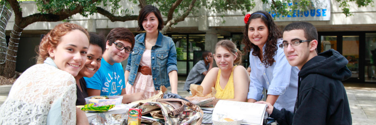 Students smiling in front of coffee shop at MDC Kendall Campus